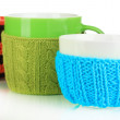Cups with knitted things on it isolated on white — Stock Photo #36492647