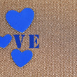 Blue hearts made of felt on golden background — Stock Photo #36493643