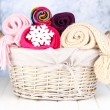Warm knitted scarves in basket on winter background — Foto de Stock
