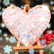 Decorative heart on easel, on wooden table, on shiny background — Foto de Stock