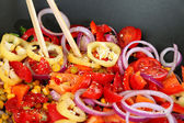 Vegetables in wok close-up background — Stock Photo