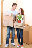 Young couple moves into new home — 图库照片