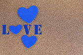 Blue hearts made of felt on golden background — Stock Photo