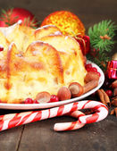 Tasty homemade Christmas cake, on grey wooden background — Foto Stock