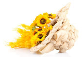 Small straw hat with flowers, isolated on white — Stock Photo