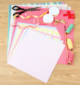 Paper for scrapbooking and tools, on wooden table — 图库照片