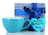 Happy Fathers Day tag with gift box and cup, isolated on white — Stock Photo