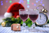 Wine glasses and Christmas decoration on bright background — Stock Photo