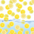 Fresh slices of lemons dropped into water — Stock Photo