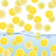 Stock Photo: Fresh slices of lemons dropped into water