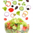 Fresh mixed vegetables falling into bowl of salad isolated on white — Stock Photo #36562959