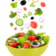 Fresh mixed vegetables falling into bowl of salad isolated on white — Stok fotoğraf #36563247