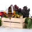Bottles and glasses of wine and assortment of grapes in wooden crate, isolated on white — Stock Photo #36569983