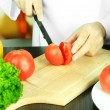 Cook hands cutting tomato — Stock Photo #36571877