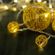 Christmas decorative balls and garland, on wooden background — Stock Photo