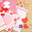 Stock Photo: Beautiful hand made post cards and scrapbooking elements, on wooden table