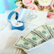 Dollar bills in envelope as gift at wedding on wooden table close-up — Stock Photo #36575991