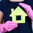 Housewife holding house model, close up — Stock Photo