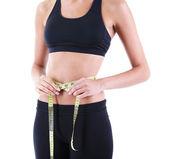štíhlá dívka s centimetr izolovaných na bílém — Stock fotografie