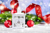 Composition with Christmas lantern, fir tree and decorations on light background — Stock Photo