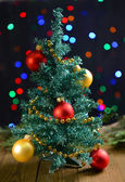 Decorative Christmas tree on table on bright background — Stock Photo