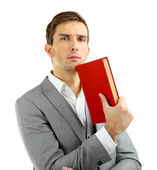 Young teacher with book isolated on white — Stock Photo