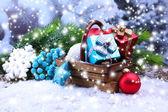 Composition with Christmas decorations in basket, fir tree on light background — 图库照片