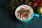 Hot chocolate with cream in color mug, on table, on Christmas decorations background — 图库照片