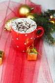 Hot chocolate with cream in color mug, on table, on Christmas decorations background — ストック写真
