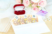 Euro banknotes as gift at wedding on wooden table close-up — 图库照片