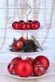 Christmas decorations on dessert stand, on wooden background — ストック写真