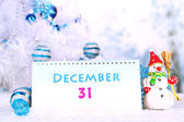 Calendar with New Year decorations on winter background — Photo