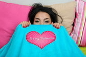 Beautiful woman in bed on Valentine Day — Stock Photo