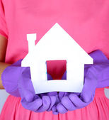 Housewife holding house model, close up — Foto Stock