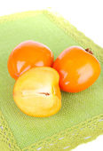 Ripe persimmons on table on white background — Stock Photo