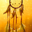 Stock Photo: Beautiful dream catcher on yellow background with lights