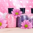 Aromatherapy minerals - colorful bath salt on pink background — Stock Photo