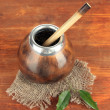 Calabash and bombilla with yerba mate on wooden background — Stock Photo