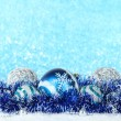 Composition of the Christmas decorations on light blue background — Stock Photo