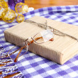 Composition with old book, eye glasses, and plaid on wooden background — Stock Photo