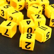Educational cubes with different numbers on black board — Stock Photo