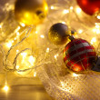 Christmas ornaments and garland on bright background close-up — Stok fotoğraf