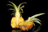 Sliced ripe pineapple isolated on black — Foto de Stock