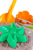 Children's toys on sand isolated on white — Stock Photo