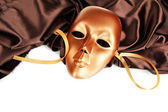 Mask on brown fabric on white background — Stock Photo