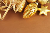 Beautiful Christmas decorations on brown background — Foto Stock
