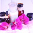 Beautiful spa setting with orchid on white wooden table close-up — Stok fotoğraf
