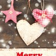 Decorative hearts and star on rope, on wooden background — Stockfoto