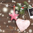 Decorative heart, star and empty photo paper on rope, on wooden background — Foto de Stock
