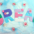 Word Dream created with brightly colored knitting yard on fabric background — Stock Photo